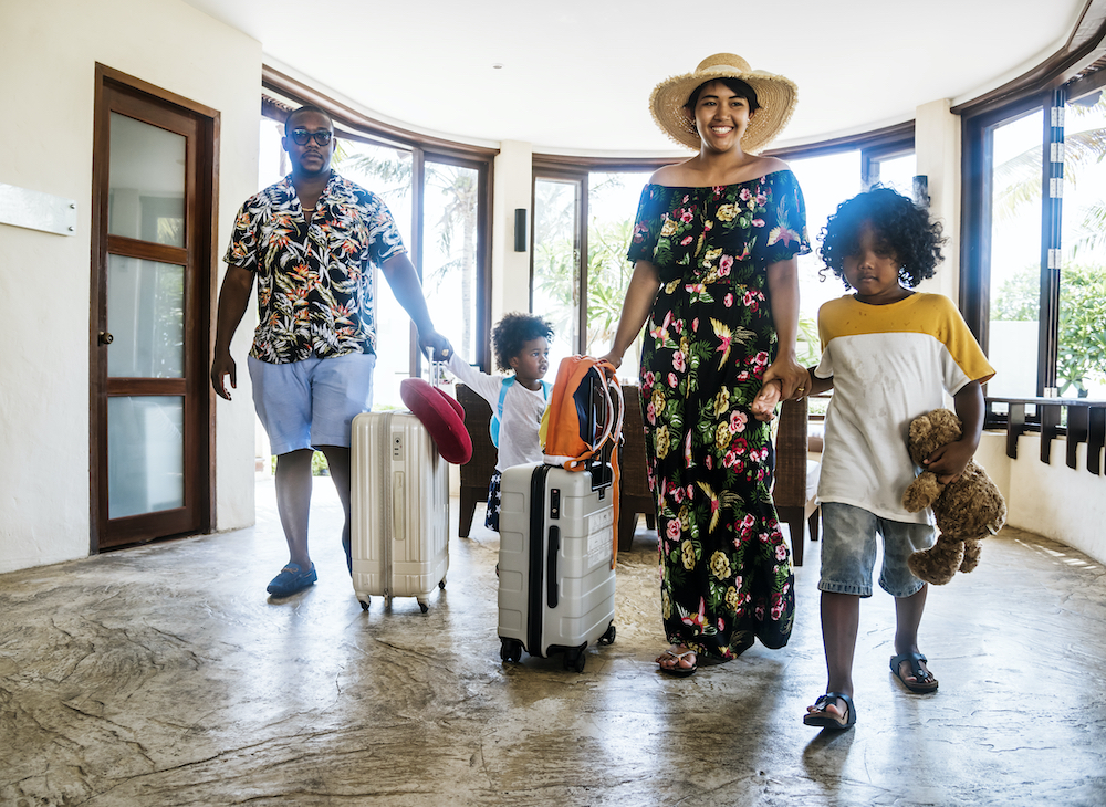 Family entering a tropical hotel